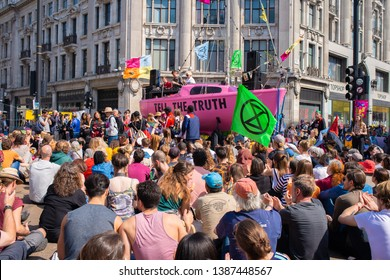 London, UK, 19th April 2019. Climate change/eco protesters at the Extinction Rebellion demonstration, at Oxford Circus, London, in protest of world climate breakdown and ecological collapse.