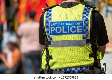 London, UK. 19th April 2019. British Transport Police sign on the back of an officer's high visibility jacket, while on duty during an Extinction Rebellion protest demonstration in central London, UK.