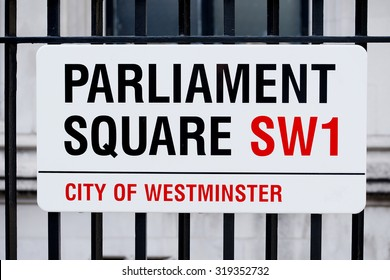 London, UK.  19th September 2015. London street sign for Parliament Square SW1, attached to railings.