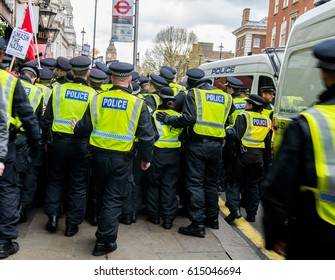 London, UK. 1st April 2017. EDITORIAL - Police officers confront protesters at the English Defence League / Britain First rally with counter demo by the Unite Against Fascism movement in London.