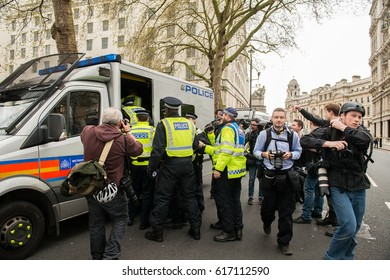 London, UK. 1st April 2017. EDITORIAL - English Defence League / Britain First rally with counter demo by the Unite Against Fascism movement in central London. Police escort the demos to keep order.