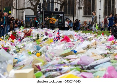 London, UK - 1st April, 2017: Parliament Square has been covered with flowers for those killed in terrorist attack, London, Uk.