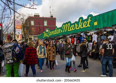 LONDON, UK - 1ST MARCH 2014: The Entrance to Camden Market with shoppers outside walking past or browsing the stalls