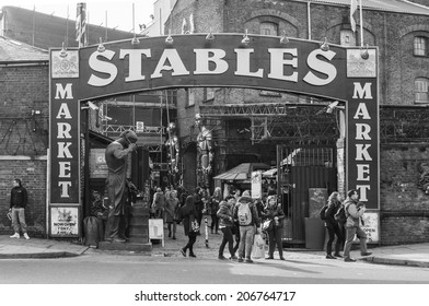LONDON, UK - 1ST MARCH 2014: The Entrance to the Stables Market in Camden showing shoppers near the entrance