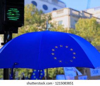 London, UK -20, October 2018: Blue umbrella with symbol of European Union and green street light at Trafalgar Square in London