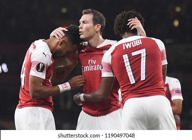 LONDON, UK - 20 SEPTEMBER, 2018: Stephan Lichtsteiner kisses Pierre-Emerick Aubameyang after a goal scored during the UEFA Europa League Group E game between ARsenal and Vorskla Potlava.