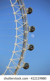 London, UK. 20.04.2016. A close-up view of the London Eye with the moon in the background.