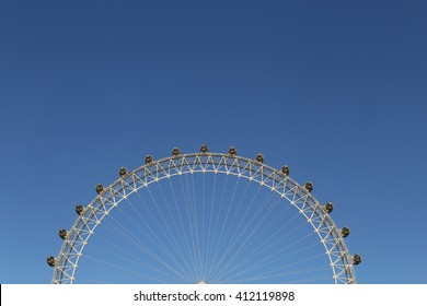 London, UK. 20.04.2016. A partial view of the London Eye under a very blue sky, with half of the picture free to put text.