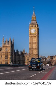 LONDON, UK - 20TH APRL 2013: Views of Big Ben and Westminster during the day. A taxi can be seen in the foreground.
