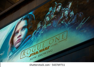 London, UK. 20th December 2016. EDITORIAL - Low angle view, of the Odeon Cinema in Leicester Square, London, with large LED display for the screening of the film - Rogue One - A Star Wars Story.