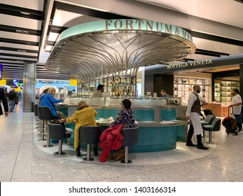 London, UK - 20th May 2019: Fortnum and Mason cafe bar in Heathrow Airport. This famous London retailer is renowned for fine food, teas, coffees and wine.