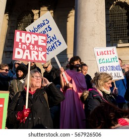 London, UK - 21 January 2017. Women holding protest signs for women rights.Protesters gathered in Trafalgar Square to attend Women's March against Donald Trump calling for human rights and equality.