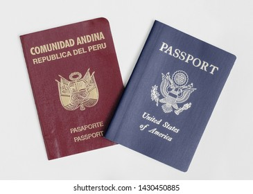 London / UK - 21st June 2019 - Peru and US passports, isolated on a white background.