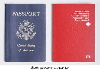 London / UK - 21st June 2019 - US and Swiss passports on a white background