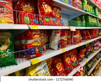 London, UK - 22 August 2018: Walkers and lays crisps on a shelf in a supermarket.