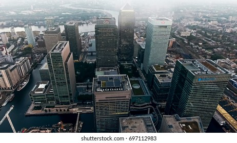 LONDON, UK - 22 JULY 2016 : Aerial View Photo of London City Financial District and Skyscrapers in Canary Wharf Helicopter Flight Bird's Eye View Business Buildings on 22 July 2016 in England UK