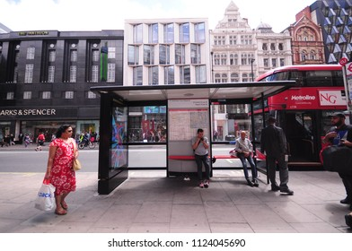 LONDON, UK. 22 June 2018: Modern red double decker bus stops at bus stop in Oxford road.