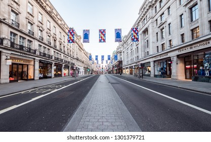 LONDON, UK - 22 MAY 2018: A rare view of Regent Street with no traffic or pedestrians.  In the heart of Londons busy shopping district, Regent Street is normally gridlocked with human traffic.