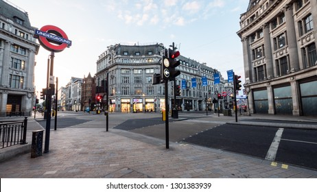 LONDON, UK - 22 MAY 2018: A rare view of Oxford Circus with no traffic or pedestrians.  In the heart of Londons busy shopping district, Oxford Circus is normally gridlocked with human traffic.