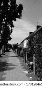 LONDON/ UK- 22nd July 2020: Pathway on residential avenue in East London, taken in black and white.