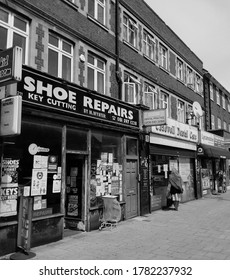 LONDON/ UK- 23rd July 2020: Old Shoe repair shop on, east London high street, taken in black and white.