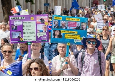 London, UK; 23rd June 2018; Pro-EU Protersters Marching Down Whitehall on the Peoples Vote March.  Two Women hold  Brightly coloured Placards