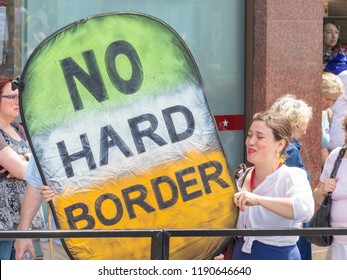 London, UK; 23rd June 2018; Pro-EU Protester on the Peoples Vote March Holds a Large Homemade Sign About the Brexit Irish Border Issue
