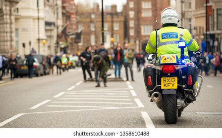 London, UK. 23rd March 2019. Police motorcycle riders, escort and clear the roads ahead of any traffic for a planned street demonstration which is following close behind through central London, UK.