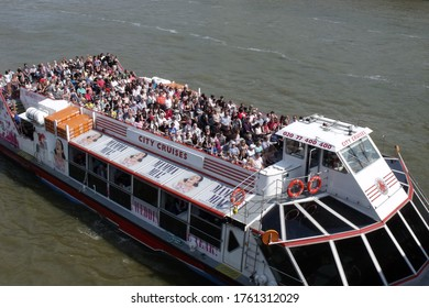 LONDON/ UK- 23rd May 2011: People enjoying an open air city cruise, along the river thames in London.