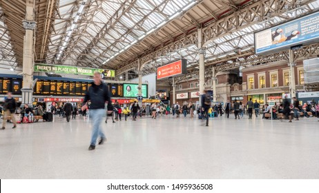 LONDON, UK - 24 APRIL 2019: High key, long exposure abstract capture of travellers and commuters on the concourse of London Victoria, one of the largest train stations in the city.