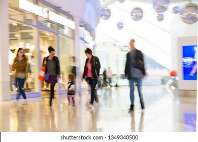 London, UK - 24 March, 2019: Walking people blur in the Shopping centre North Greenwich. New modern residential aria with wide range  entertainment infrastructure