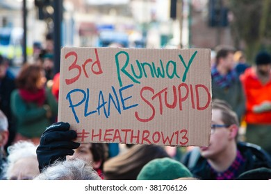 London, UK 24th February 2016. Unidentified supporter holds a placard outside Willesden Magistrates' Court in North West London to show support for the Heathrow13.