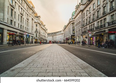 LONDON, UK - 24TH MARCH 2015: A view of Regent Street during the day, showing shops, buildings and people.