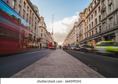 LONDON, UK - 24TH MARCH 2015: A view of Regent Street during the day, showing shops, buildings and the blur of people and traffic