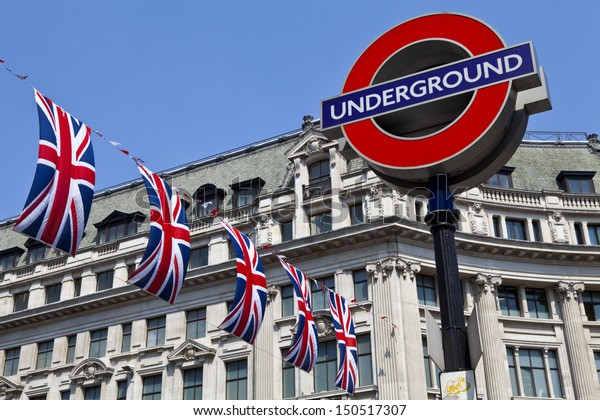 LONDON, UK - 24TH MAY 2012: London Underground sign and Union Flags in London.