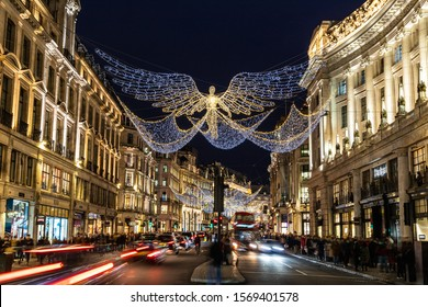 LONDON, UK - 24TH NOV 2019: Regent Street in London during the Christmas holidays showing the lights and decorations. People can be seen on the street.