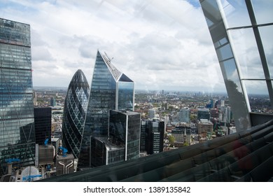 London, UK - 25 April, 2019: City of London office buildings, famous London's skyscrapers view with beautiful sky reflection in the glass.