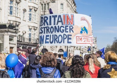 London, UK - 25 March 2017: Demonstrates carry large banners supporting Britain's ties with Europe as they participate in the Unite for Europe March in central London, UK