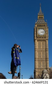 London, UK - 25 March 2017: Protester clothing a European Union (EU) flag and photographing the famous Big Ben clock during a Unite for Europe march against Brexit.
