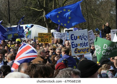 London, UK. 25 March, 2017. EU flags held aloft at an anti-Brexit rally in London, England. The crowd moved across the city before gathering at Westminster to protest against the Brexit process.