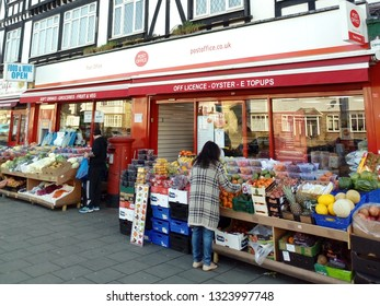 LONDON/ UK- 25th February 2019: A lady shopping for fruit and vegetables at a high street store in, east London.  These smaller stores are struggling with the competition from larger supermarkets.