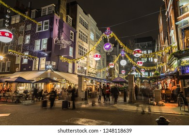 LONDON, UK - 25TH NOVEMBER 2018: St Christophers Place in London at Christmas. Showing the festive lights and decorations, restaurants, buildings and people.