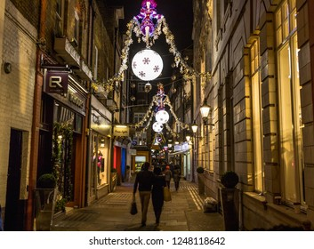 LONDON, UK - 25TH NOVEMBER 2018: Gee's Court and St Christophers Place in London at Christmas. Showing the festive lights and decorations, restaurants, buildings and people.