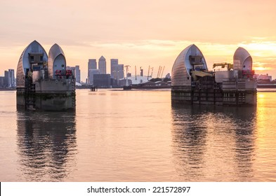 London, UK -26 July 2014: London's flood barrier on river Thames and Canary Wharf