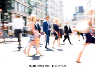 London, UK - 26 June, 2018: Business people and office workers crossing the road. Walking people motion blur. City of London busy business life.