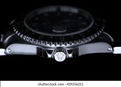London, UK - 26 March 2016: A black bezel Rolex GMT Master II reference 16710 mechanical watch.  Known as the black GMT. A macro of the winding crown featuring the Rolex Crown logo.