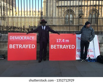LONDON, UK - 26 MARCH 2019: Brexit 'leave' protesters in front of parliament with heavy banners.