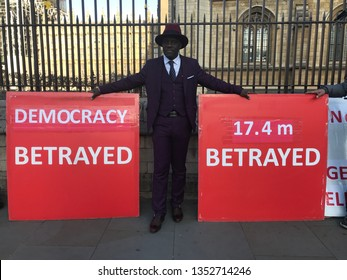 LONDON, UK - 26 MARCH 2019: Brexit 'leave' protester in front of parliament with heavy banners.