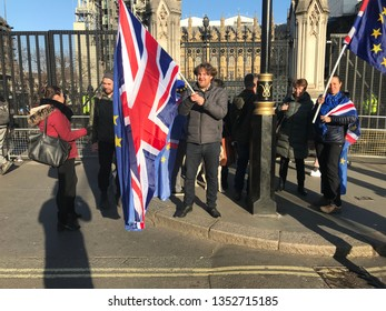 LONDON, UK - 26 MARCH 2019: Brexit 'stay' protesters in front of parliament with Union Jack and European flags.