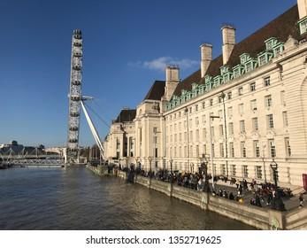 LONDON, UK - 26 MARCH 2019: London eye on the Thames river.